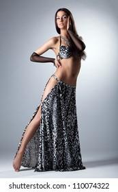 Beauty dancer posing in arabian costume