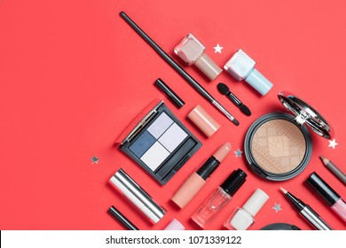 Beauty, decorative cosmetics. Makeup brushes set and color eyeshadow palette on red and blue background , flat lay, top view, Minimalistic style