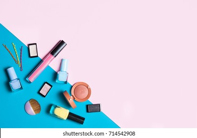 Beauty, decorative cosmetics. Makeup brushes set and color eyeshadow palette on pink and blue background , flat lay, top view