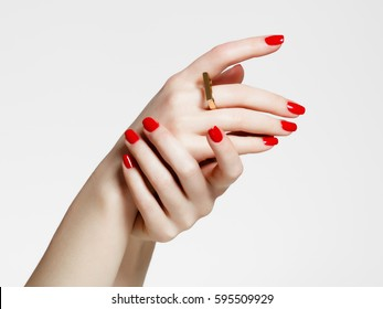 Beauty delicate hands with manicure close up. Beautiful female fingers with manicure and fashionable gold ring. Beautiful nails close-up, great idea for the advertising of cosmetics