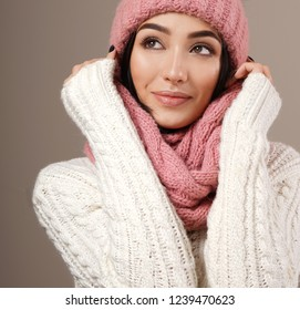 beauty face care portrait of attractive young caucasian woman in warm clothing  studio shot toothy smiling winter