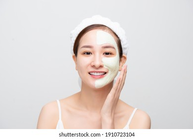 Beauty Face Care. Portrait Of Young Asain Girl Touching Her Perfect Soft Facial Skin. Over white background.