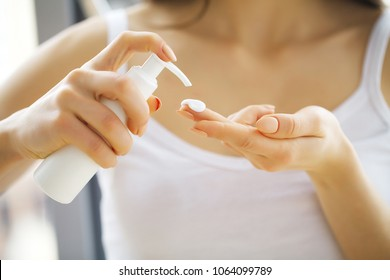 Beauty Face Care. Woman Applying Cream On Skin.