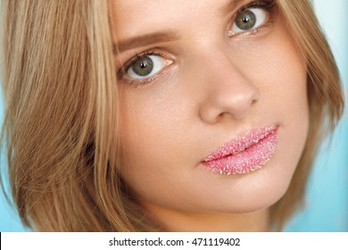 Beauty Face. Closeup Portrait Of Beautiful Young Woman With Fresh Soft Pure Skin, Sweet Plump Full Lips With Cosmetic Sugar Lip Scrub On. Lip Care Cosmetics Concept. High Resolution Image