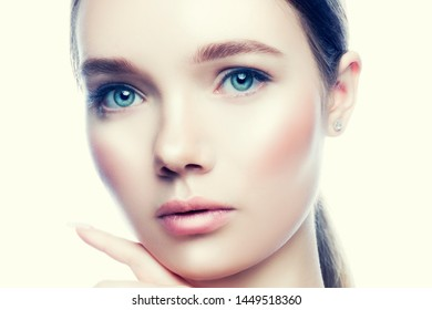 Beauty face close-up with young model woman with healthy perfect skin, natural make-up, studio portrait. Skincare facial treatment concept