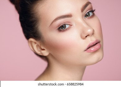 Beauty Face Cosmetics. Portrait Of Beautiful Young Woman With Smooth Pure Skin And Fresh Natural Makeup. Closeup Of Attractive Sexy Girl Posing On Pink Background. Skin Care Concept. High Resolution
