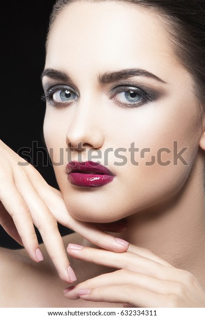 Beauty face of fashion woman model with glamour bright makeup, dark red lipstick. Evening catwalk visage, trend vogue style
