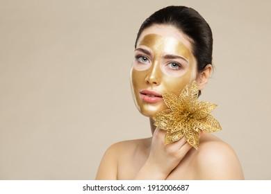Beauty Face Gold Mask. Woman Golden Peel off Moisturizing Facial Mask. Luxury Cosmetic Skincare - Shutterstock ID 1912006687