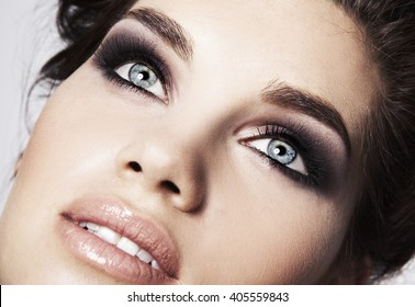 Beauty face makeup. Make up. Eyelashes extensions. Perfect Make-up closeup. Foundation. Cosmetic Eyeshadows, eyebrows. Beauty Girl with Perfect Skin. Eyelashes. Makeover