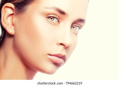 Beauty face of model girl closeup. Young caucasian woman with make-up, green eyes, natural lips and clean skin. Skincare treatment health concept