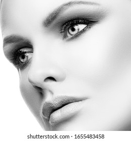 Beauty face, perfect skin. Pretty girl with big eyes, eyeshadows, beauty photo, close up woman portrait. Black and white