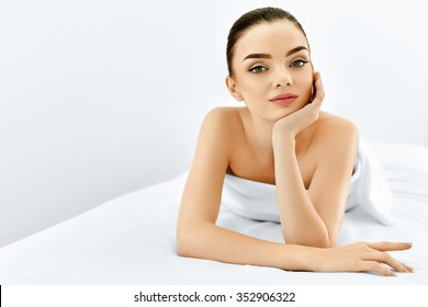 Beauty Face. Portrait Of Beautiful Smiling Model Woman Enjoying Her Perfect Fresh Clean Skin After Spa Treatment. Body And Skin Care, Cleansing And Moisturizing Concept. Healthy Lifestyle