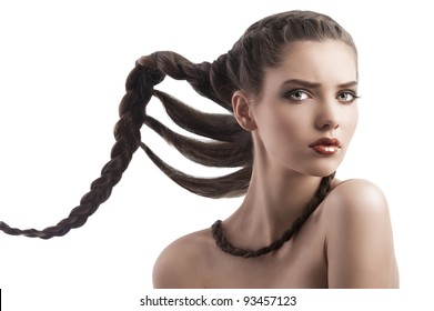 beauty face shot of a pretty brunette with long braided hair on white