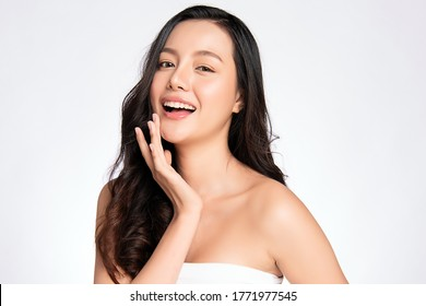 Beauty face. Smiling asian woman touching healthy skin portrait. Beautiful happy girl model with fresh glowing hydrated facial skin and natural makeup on white background, - Shutterstock ID 1771977545