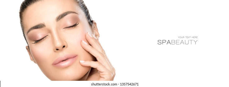 Beauty face spa woman. Studio shot close-up portrait of a beautiful young and healthy woman with closed eyes while touching the soft skin of her face. Beauty and skincare concept isolated on white.