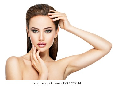 Beauty face of the young beautiful woman - isolated on white. Gorgeous female portrait with slicked brown hair. Young adult girl with healthy skin. Pretty lady with fashion eye makeup.