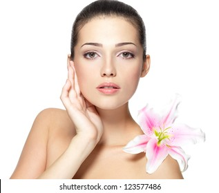 Beauty face of young woman with flower. Beauty treatment concept. Portrait over white background