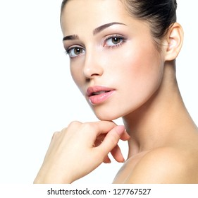 Beauty face of young woman. Skin care concept. Closeup portrait isolated on white.