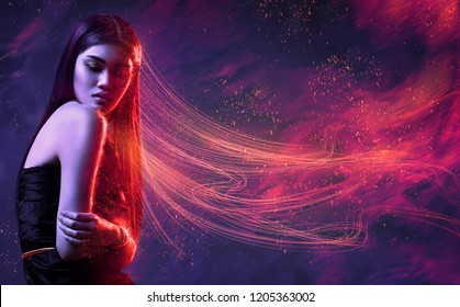 Beauty, fashion. Beautiful woman in black dress with flowing red hair and sparks