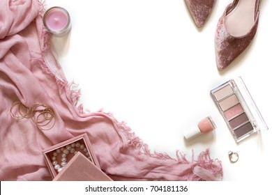 Beauty & fashion blog concept. Stylish feminine pink accessories flatlay isolated on white background. Trendy flat lay top view. Woman shoes, perfume, cosmetics. Styled stock with  negative space