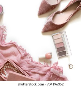 Beauty & fashion blog concept. Stylish feminine accessories flatlay isolated on white background. Minimal flat lay top view. Woman pink scarf, jewellery box, velvet shoes, ring, cosmetics