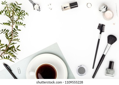 beauty and fashion blog or online shop concept. decorative cosmetics, makeup tools, accessory and coffee mug on white background with copy space for text. flat lay frame composition, top view