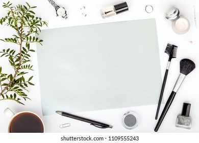 beauty and fashion blog or online shop concept. professional decorative cosmetics, makeup tools, accessory and coffee mug on white background with copy space for text. flat lay composition, top view