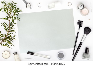beauty and fashion blog or online shop concept. professional decorative cosmetics, makeup tools and accessory on white background with copy space for text. flat lay frame composition, top view