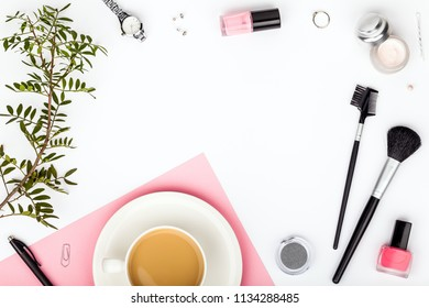 beauty and fashion blog or online shop concept. professional decorative cosmetics, makeup tools, accessory and coffee mug on white background with copy space. flat lay frame composition, top view