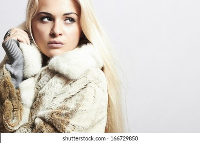 Beauty Fashion blond Model Girl in Mink Fur Coat. Beautiful Woman in Luxury Fur Jacket . Winter Fashion. your text here