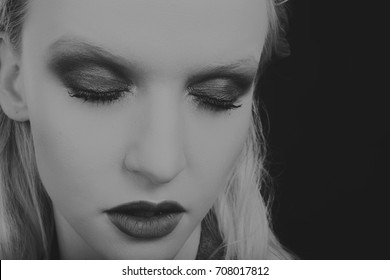 beauty fashion close-up Portrait of beautiful young woman with bright make-up. the black and white photo