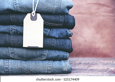 Beauty and fashion, clothing concept - stack of jeans.
