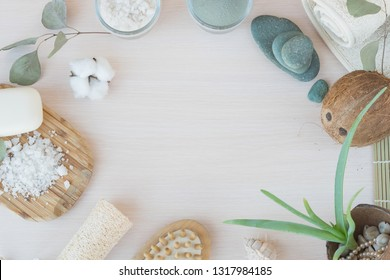 Beauty and fashion concept with spa setting. composition with Dead sea salt, coconut,  natural cosmetic blue clay,  soda, loofah. Flat lay, Spa concept with cotton flower, stones and towel.