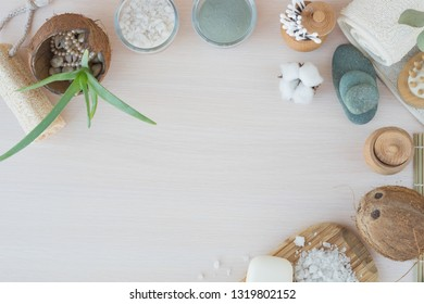 Beauty and fashion concept with spa setting. composition with Dead sea salt, coconut,  natural cosmetic blue clay, loofah. Flat lay, Spa concept with flowers, stones and towel.