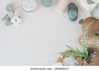 Beauty and fashion concept with spa setting and aloe Vera. composition with Dead sea salt, coconut,  natural cosmetic blue clay, loofah. Flat lay, Spa concept with flowers, stones and towel.