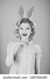 Beauty, fashion, cosmetics, vintage style. Retro woman in bunny ears, easter. Easter, makeup, pinup party, girl in rabbit ears. Pinup woman, vintage, look. Sexy blond girl with retro makeup, playboy.