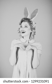 Beauty, fashion, cosmetics, vintage style. Easter, makeup, pinup party, girl in rabbit ears. Pinup woman, vintage, look. Retro woman in bunny ears, easter. Sexy blond girl with retro makeup, playboy.