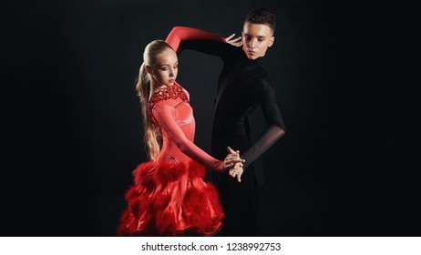 Beauty, fashion. Dancing over black background, beautiful couple of ballet dancers