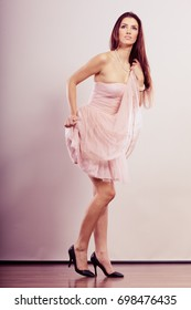 Beauty, fashion and elegant people concept - full length young brunette slim woman in bright dress and high heels shoes