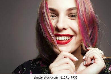 Beauty Fashion Girl with Colorful Dyed Hair. Smiling Happy Girl. Model with perfect Healthy Dyed Hair. Rainbow Hairstyles