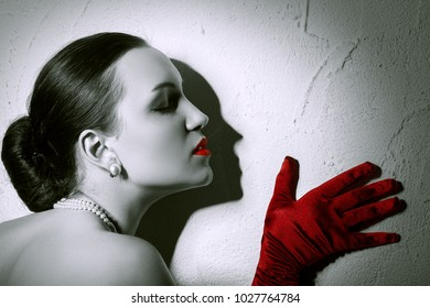 Beauty Fashion Glamorous Model female Portrait. Vintage Style Mysterious Woman Wearing Red Glamour Gloves. Jewelry. Holiday Hairstyle and Make-up