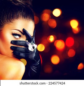 Beauty Fashion Glamorous Model Girl Portrait. Vintage Style Mysterious Woman Wearing black Glamour Gloves. Jewellery. Jewelry. Holiday Hairstyle and Make-up. Diamond Ring. Retro Lady with Blue Eyes
