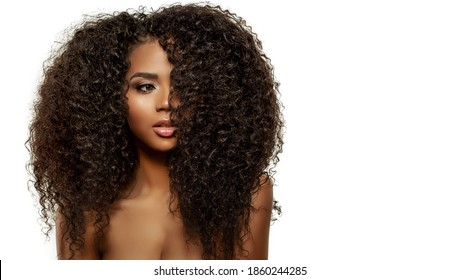 Beauty Fashion model. Black woman face & beautiful voluminous hair. Afro american girl. Beauty skin female face. 