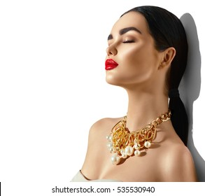 Beauty fashion model brunette girl portrait. Sexy young woman with perfect makeup and trendy golden accessories. High fashion glamour female.