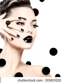 Beauty Fashion Model Girl with Black Make up, Long Lushes. Fashion Trendy Caviar Black Manicure. Nail Art. Dark Lipstick and Nail Polish. Isolated on white background