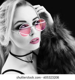 Beauty Fashion model girl black and white portrait, wearing stylish sunglasses and choker. Sexy woman portrait with perfect makeup and and blonde hair style,trendy accessories. Beauty fashion trends