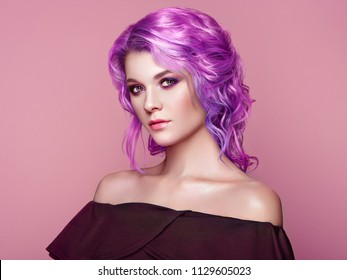 Beauty Fashion Model Girl with Colorful Dyed Hair. Girl with perfect Makeup and Hairstyle. Model with perfect Healthy Dyed Hair. Pink Hairstyles