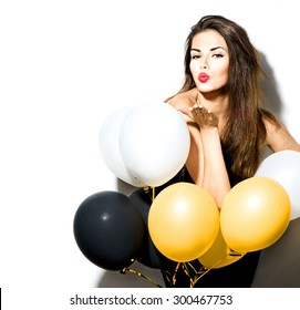 Beauty fashion model girl with colorful balloons isolated on white background. Party, holiday celebration. Beautiful sexy woman