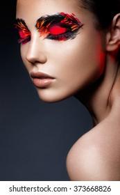 Beauty fashion model girl with dark bright orange make-up. Close up portret.