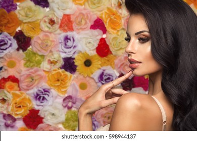 Beauty fashion model girl with flowers